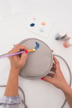 an easy way to add new life to any purse! - Oh Joy! Leather Purse Diy, Leather Craft, Leather Bags, Embellished Purses, Painted Bags, Hand Painted, Circle Purse, Custom Purses, Custom Painted Shoes