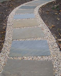 Stone and gravel path. from driveway to front porch