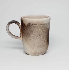 handmade porcelain mug, glazed and smoked fire. www.caroleneilson.com