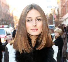 Olivia Palermo, long bob centre part, no fringe.