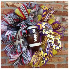 Alabama LSU house divided football wreath. Follow Created By Terri/Crafts & Creations By Terri www.facebook.com/CraftsandCreationsByTerri  www.etsy.com/shop/CreatedByTerri Instagram @ CreatedByTerri  Twitter @ designsbyterri #craftsandcreationsbyterri #createdbyterri #etsy #doorwreaths #lsutigers #alabama
