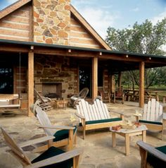 Outdoor patio with stone fireplace #StoneMill #Loghome #logcabin #Rustic