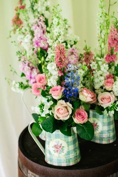 Colorful flowers in pretty gingham jugs
