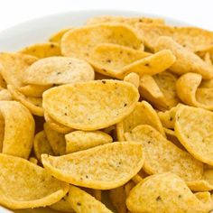 Homemade Corn Chips - 1Ccornmeal 1Toil 1/2tsalt Bring 3/4 to 7/8C water to a boil  add cornmeal, salt,  oil. Scoop 1 heaping teaspoon full of mixture for each chip  place it on well-greased baking sheet. (Be sure to use plenty of oil, or they will stick) Moisten your fingers  pat the chips out thin. Bake in 400° F oven for about 10 minutes.