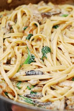 Creamy mushroom pasta with caramelized onions and spinach - a delicious Italian-style dish!