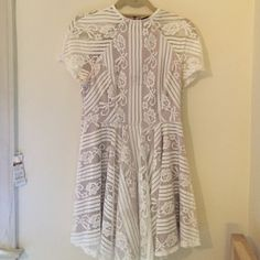 Lace dress. Only worn once! White lace dress with nude fabric underneath. Only worn once to a formal! Size is an AUS10 but fits perfectly on someone who wears a size M (perfect for those with a smaller top body and larger butt like myself!). Not from Sabo Skirt, but from a similar store (JeanJail) in AUS!  No trades please only serious offers because this dress is perfect! Make me an offer :) Sabo Skirt Dresses
