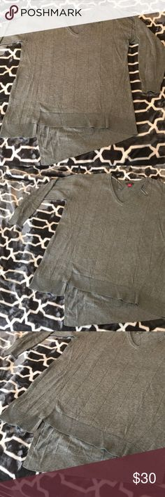 Vince Camino assymetrical has gray sweater Great sweater  Asymmetrical hem  Worn a couple of times  Great with leggings and boots  No signs of wear Vince Camuto Sweaters V-Necks