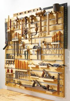 Look at this perfect tool rack organization. It was made from new wood in the link where we found it, but could easily be made out of pallets ! ++ American woodworker