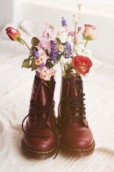 Soft grunge quintessential doc martens and flowers.