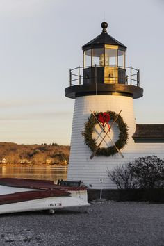 A Replica Of Nantucketu0027s Brant Point Lighthouse Adorned With A Christmas  Wreath At Mystic Seaport.