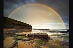 From the Australian Weather Calendar 2012 ... January: Double rainbow over Wombarra beach, New South Wales.