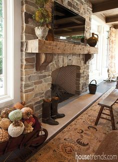 A stone fireplace with a rough-hewn mantle light up this room with some charm. #housetrends                                                                                                                                                      More