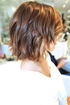 The shorter, slightly feathered layers in this medium-length bob add rock chic texture. Read more: http://www.dailymakeover...