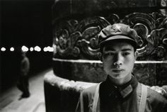 Young red guard in front of the People Palace, Beijing, 1971, by Marc Riboud