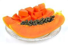 Picture of Ripe papaya, Pawpaw or Tree melon (Carica papaya L) which Rich in Betacarotene, Vitamin C, Fiber and Papine Enzyme. stock photo, images and stock photography. Healthy Fruits, Lower Cholesterol, Vitamin C, Benefit, Fiber, Nutrition, Treats, Snacks