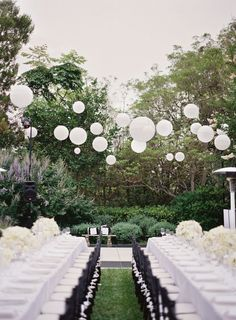 Outdoor garden wedding reception. Long table setting, white tablescape, black chiavari chairs and hanging lanterns  Read More: http://www.stylemepretty.com/2014/01/20/classic-pacific-palisades-wedding/
