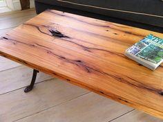 "Reclaimed barnwood coffee table with ""antique school desk"" metal legs"