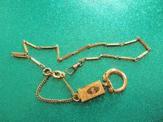 """ANTIQUE YELLOW 12 KT GOLD FILLED POCKET WATCH CHAIN & FOB SIGNED """"SIMMONS"""" 18""""  #Simmons"""