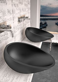 limestone counter wall, black sink