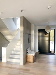 Sunny morning in the hallway # hallway # entrance area # entrance # exposed concrete # minimalism # new building # concrete stairs # staircase Entrance page 3 Stairs Architecture, Modern Architecture, Concrete Stairs, Exposed Concrete, House Stairs, House Entrance, Entrance Hall, Entrance Ideas, Entry Hallway