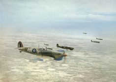 Supermarine Spitfire Mk Vbs of No. 417 Squadron, Royal Canadian Air Force, flying in loose formation over the Tunisian desert on a bomber escort operation, April 1943.