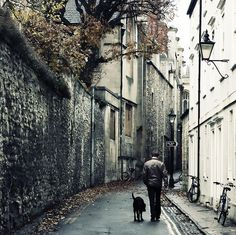 A man, a dog, and a lonely street by edmundlwk, via Flickr