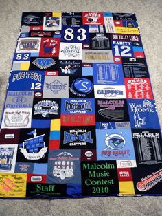 T-shirt quilts. She has two designs on the blog, no tutorials but for ideas. The other one has about 40 squares, all shirts cut the same size and small squares cut from sleeves around the border.