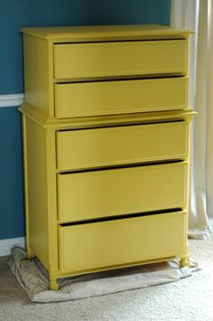 The yellow dresser....Maybe if i could find a cheap dresser like this i could paint it blue for my master bedroom!  (although i love the yellow!)