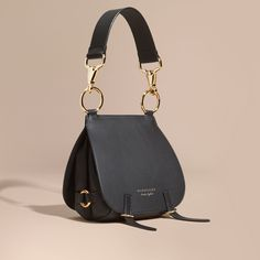 Our equestrian-inspired runway satchel in smooth bridle and grainy leathers. Reflecting traditional British saddlery, the soft practical shape is crafted with utilitarian clasps, a grooved border and burnished edges.