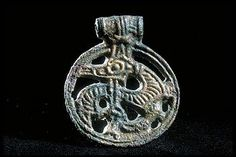 Viking age dragon pendant from Uppland, Sweden. Swedish History Museum.