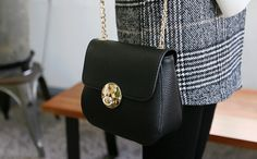With its long gold chain this mini shoulder bag is perfect for that casual look.