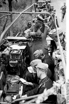 German General Heinz Guderian in a SdKfz. 251/3 halftrack vehicle, France, May 1940; note Enigma machine