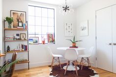 "In the dining nook, modern pieces like the Eames-esque chairs and <a href=""http://www.westelm.com/products/mobile-chandelier-small-w1878/?pkey=cchandeliers"" target=""_blank"">sputnik pendant</a>, combine with classic rustic accents like the <a href=""http://decohides.com/"" target=""_blank"">hide rug</a>."