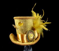 Gold on Gold Empress Collection Mini Top Hat Fascinator, Alice in Wonderland, Mad Hatter Tea Party, Derby Hat by TheWeeHatter on Etsy https://www.etsy.com/listing/244052877/gold-on-gold-empress-collection-mini-top