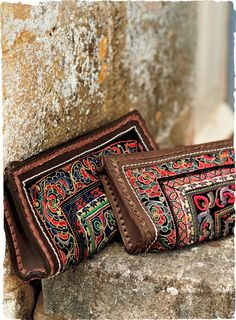 Like a fabulous market find, the leather-framed clutches are handcrafted using authentic ceremonial textiles from Thailand. Each bag is a one-of-a-kind collectible. Features a zip-top, full lining, inside pockets and key ring.