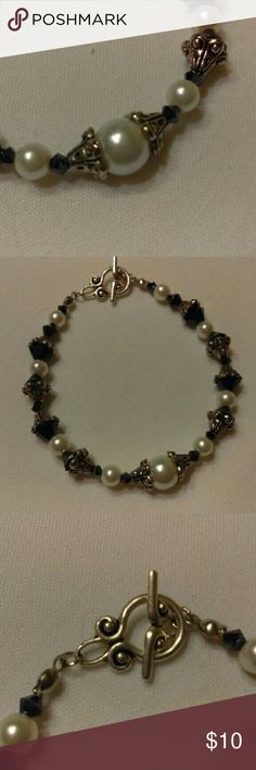 """Handmade Beaded Bracelet White/Black/Silver Handmade beaded bracelet made with white glass pearls, black bicone crystals and silver accents. This bracelet measures 7.5"""", which is the average bracelet size. An extender can be added if necessary at no charge. Jewelry Bracelets"""