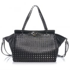 This is an authentic VALENTINO GARAVANI Vitello Leather All Over Stud Rockstud Tote in Black.   This stunning tote is beautifully crafted of smooth black leather with silver diamond studs that line the borders and the surface of the bag for a stunning look.