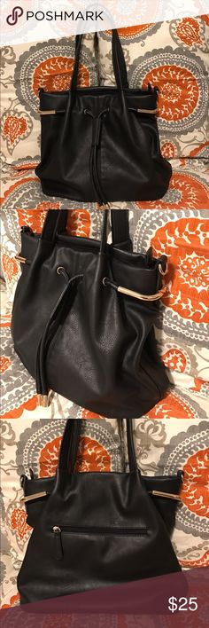 Beautiful black faux leather bag This bag is stunning. Brand new. Used only once in a staging display. It has the look and feel of a high end leather bag. Beautiful gold handle embellishments on both sides. Zipper pocket in back. Plenty of inside storage. Comes with an extra shoulder strap. Excellent condition. I welcome your offer  Bags Shoulder Bags