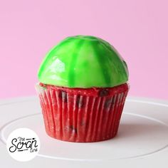 Vanilla and cheesecake cupcakes with a watermelon mirror glaze.