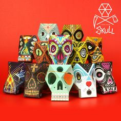 Paper skulls for folding and pasting, 13 units illustrated by contemporary artists, die cut and prefolded with numbers to guide you in the