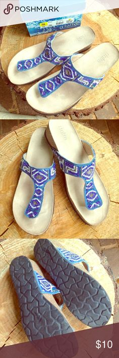 Rialto Clever Blue Sandals Rialto Clever Blue Sandals with beaded straps and comfort toe bar and footbed with 2 inch wedge with original box. Great condition. Coordinates with denim and blue cuff bracelet featured in this closet. Rialto Shoes Sandals