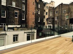 Framless glass balustrade with base fixed U-channel, toughened laminated glass and no top rail