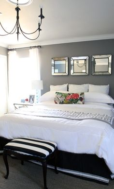 grey wall white bedspread with mirrors on wall and chandelier - home decor - bedroom decor