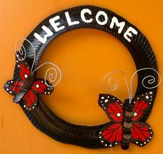 Recycled Tire Door wreath with butterflies www.cooltireswings.com