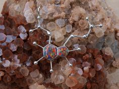 LOVE THIS. Opal psilocybin molecule.  If you love me, you'll buy this for me. :)
