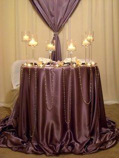 I kinda like the beads draped on the table...for like the sign-in table or cake-table or gift table...