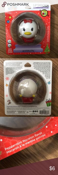 Lip Smacker Tsum Tsum Collectible Lip Smacker Tsum Tsum Collectible Daisy Duck edditon  Peppermint Macaron Flavor  Daisy collectable lip gloss, lip balm, chapstick  Collect and stack them all. New in package Lip Smacker Makeup Lip Balm & Gloss