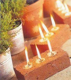 tea lights in the holes of bricks--great idea!  Facebook source