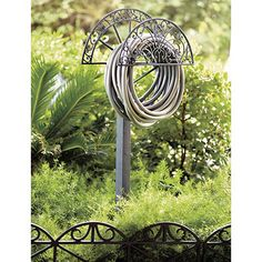 Valencia Garden Hose Stand - The pretty fan-shaped scrolls help hide the hose and four spikes hold the stand firmly in ground