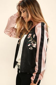 The Girl Squad Pink and Black Embroidered Satin Bomber Jacket will be the official uniform of your crew! Shiny satin shapes this trendy pink and black bomber jacket with a collarless neckline, and elasticized cuffs and hem. Cream, pink, magenta, and green floral embroidery blooms across the bodice. Shiny silver front zipper and side seam pockets.